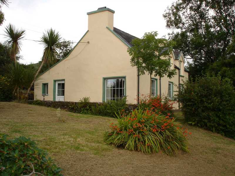 Traditionele cottage genaamd Scottishgarden